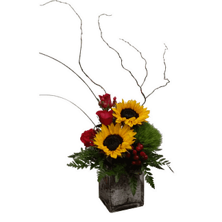 Flower arrangement for any occasion arranged with sunflowers, roses and foliage in a glass cube container