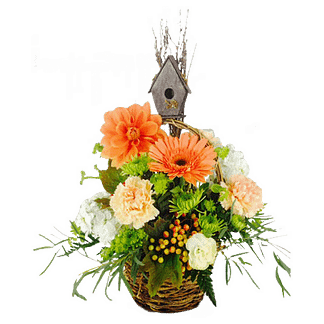 Flower arrangement for All Occasions with birdhouse pick, carnations, dahlia and more arranged in a handled basket