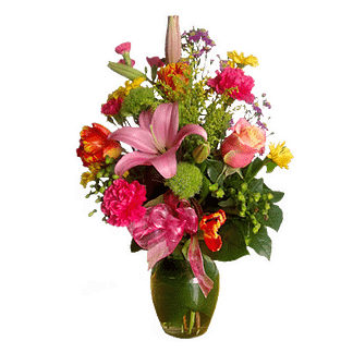 Flower arrangement for all occasions with day lilies, daisy poms, roses, carnations and more in a garden vase
