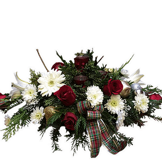 Christmas centerpiece with roses, cushion poms, oriental lilies, evergreens, ornament balls, votive candles and ribbon