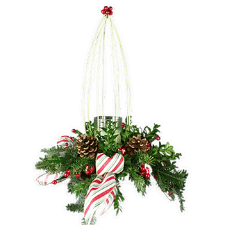 Christmas flower arrangement with evergreens, pincones, permanent berries and more in centerpiece container