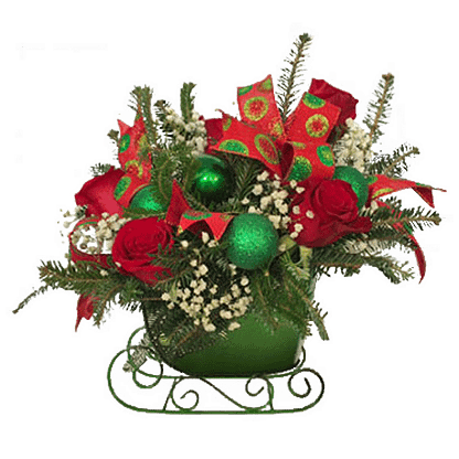 Christmas flower arrangement with evergreens, roses, baby's breath and ornament balls arranged in a sleigh