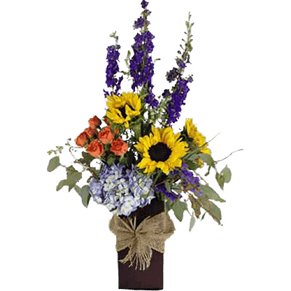 Summertime flowers arranged in a unique vase with burlap bow