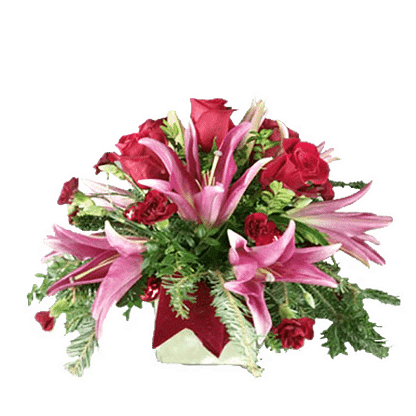 Christmas flower arrangement with oriental lilies, roses, mini carnations, evergreens, huckleberry, velvet and stem balls