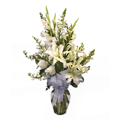 Flower arrangement for any occasion with oriental lilies, roses, gladiolus and more arranged in a garden vase with ribbon bow