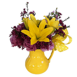 Flower arrangement for any occasion with daylilies, roses, waxflower and mini carnations arranged in a yellow container with ribbon