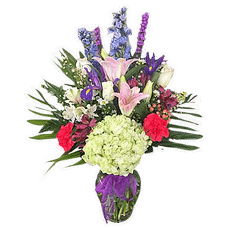Flower arrangement for any occasion with hydrangea, lilies, iris, liatris, and more, arranged in a glass vase with a purple bow