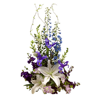 Flower arrangement for all occasions with oriental lilies, delphinium, alstroemeria and more in a low container