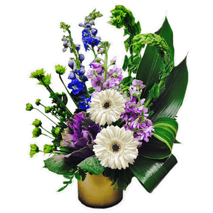 Flower arrangement for Valentine's Day or any occasion arranged with gerberas, delphinium, stock, ornamental cabbage and more.