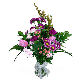 Flower arrangement for any occasion with carnations, tulips, daisy poms, and more arranged in a garden vase with ribbon