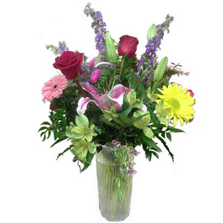 Flower arrangement for any occasion with roses, alstroemeria, lilies and more arranged in a glass vase