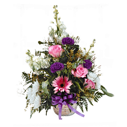 Flower arrangement for All Occasions with roses, carnations, gerbera, and more arranged in a low basket