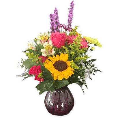 Flower arrangement for any occasion with sunflower, liatris, roses, alstroemeria, solidaster, gerbera, poms, babay's breath and greenery more arranged in a colored glass vase