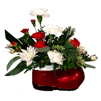 Christmas flower arrangement with carnations, pompons, evergreens and seeded eucalyptus arranged in Santa's boot