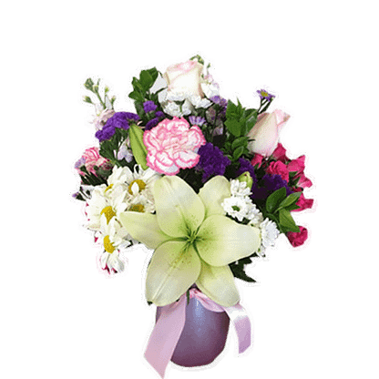 Flower arrangement for any occasion with lilies, roses, daisy poms and more, arranged in a colored glass vase with ribbon bow