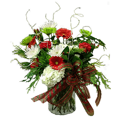 Christmas flower arrangement with gerberas, carnations, hydrangea, hypericum, fuji mums and more in a cylinder vase