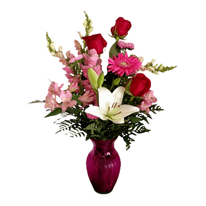 Flower arrangement for all occasions with lilies, roses, gerberas and more in a glass vase