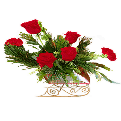 Christmas flower arrangement with roses and evergreens in a sleigh