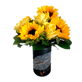 Flower arrangement for all occasions arranged with roses, sunflowers, and greenery