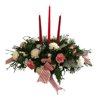 Christmas centerpiece with evergreens, carnations, decorations, candles and decorative ribbon