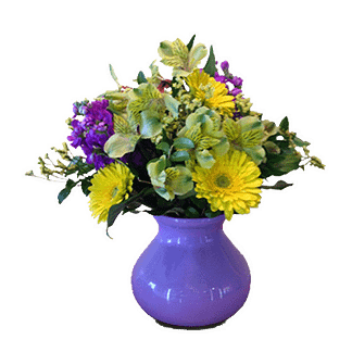 Flower arrangement for all occasions with alstroemeria, gerberas, stock, limonium and greenery in a purple ceramic pot