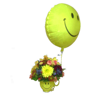 Flower arrangement for all occasions with mini carnation, pompons, happy face mylar and more in a happy face mug